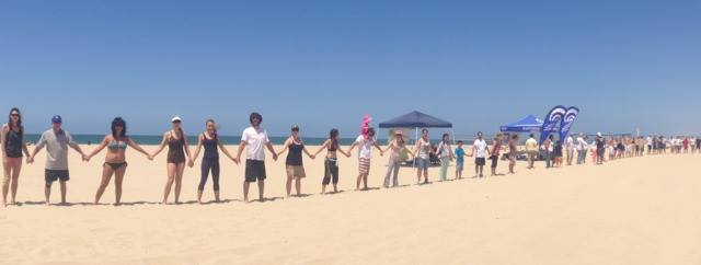 Members of South Bay Chapter join hands in Hermosa Beach, CA