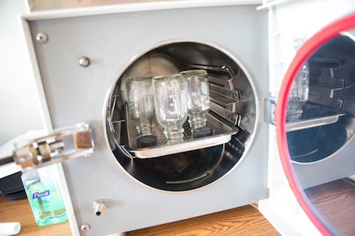 Autoclave with reusable glass bottles.